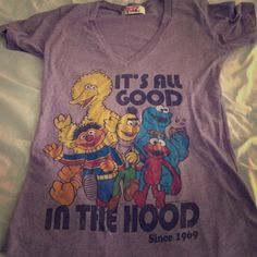Sesame Street Tee Size tag ripped out but I think it's an XS. Length from shoulder to bottom is 24 inches. Has a faded vintage look, and a good amount of stretch. Color is light purple. Mighty Fine Tops Tees - Short Sleeve