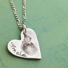 Heart shaped pendant with fingerprint impression and small swarovski drop. Fingerprint jewellery by Pure Charm