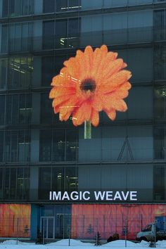 Transparent LED Mesh Media Facade IMAGIC WEAVE is a fusion of HAVER Architectural Wire Mesh and the latest LED Technologie. Projekt: Hypercube Moscow