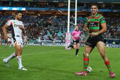 Greg Inglis of the Rabbitohs counts his tries as he celebrates scoring a try during the round 10 NRL match between the South Sydney Rabbitohs and the Wests Tigers at ANZ Stadium on May 17, 2013 in Sydney, Australia.