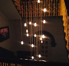 Filament lamps in a stair well. On antique cord. Chic!