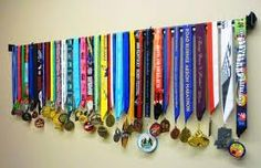 What I plan on doing with all my medals.  Place them on a curtain rod and hang in the family room.
