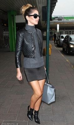 Cheryl Cole wearing Charcoal Turtleneck, Black Quilted Leather Bomber Jacket, Black Quilted Mini Skirt, Black Leather Ankle Boots, and Light Blue Leather Shopper Handbag