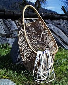 Baby Basket and Dentalia-Shell Necklace. Baby baskets, woven from hazel sticks and willow roots,  are still commonly used among the Hupa people to cradle their newborns. Over ninety percent of Hupa babies are still carried in a baby basket. The necklaces are used for ceremonial purposes and are made of dentalia shells worked into beads. Dentalia shells were a valuable item of trade to the Hupa and their neighbors. Some finely worked dentalia shells were used as money. LBD
