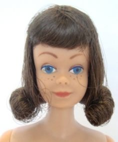 Midge--I never had a Barbie when I was growing up, but I did have Midge and my mother bought actual dress patterns and made clothes for her.