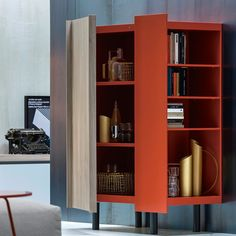 """Novamobili Sessanta Sideboard  Novamobili Sessanta #Sideboard: as its name (#Italian for sixty) suggests, this is a new take on an """"old-fashioned"""" sideboard. Available in all lacquered colours, it features a hinged door with built-in edge pull in the eco-wood and foil-wrapped options only. The unit does away with the usual side panel in favour of an open end unit."""