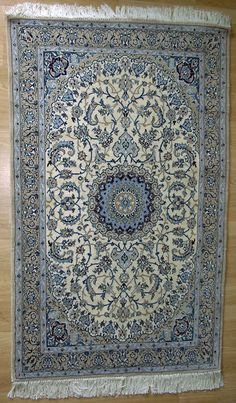 Persian carpet - handwoven in Iran. As if you didnt know im persian and want persian carpets all over my house.