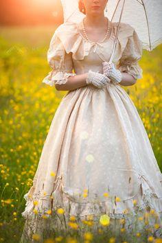 victorian woman in a buttercup meadowBY: Lee Avison