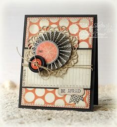 "Paper: Mischievous line by My Mind's Eye . adorable sentiments: JustRite's Halloween Mini Sentiments. They're sized perfectly to tuck in here, there, and everywhere. I stamped ""Be Afraid"" onto one edge of a punched label shape, then tucked it behind the horizontal panel and embellished with two mini banner strips. The doily is from My Favorite Things, the buttons from Papertrey, and the little spider image is something I punched from one of last year's Halloween papers (from Toil & Trouble…"