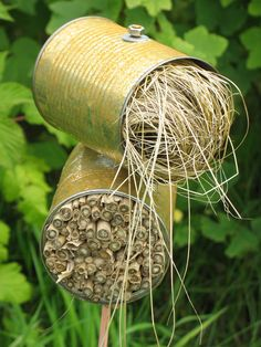 Garden marker idea: doubles as a bug hotel and write on the side of the can the crop name below. Garden Bugs, Garden Insects, Garden Pests, Garden Crafts, Garden Projects, Garden Art, Bug Hotel, Mason Bees, Garden Club