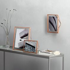 "Umbra 'Prisma' photo frames for 5x7"" prints at John Lewis, in black, brass or copper - £17.50"