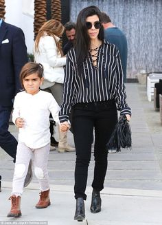 Hip kid: Mason showed off his trendy new undercut hairdo as he held mom's hand on the outi...