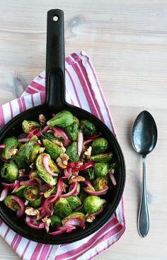 Brussels sprouts, rosemary pickled raisins and red onions with toasted walnuts. Festive looking yet easy side dish for the holidays. Vegan,gf