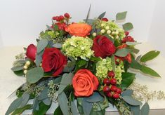 Fall centerpiece of mini green hydrangea, red roses, orange roses, and berries with greenery! #florist #flowers #flowershop #florals #flowerarrangement #floralarrangement #flowerdesign #roses #rose #hydrangea #hydrangeas #berries #redroses #orangeroses #centerpiece #centerpieces #flowersoftheday #bloomsoftheday #blooms #flowerlover #flowerlovers #flowerpower #flower #floral