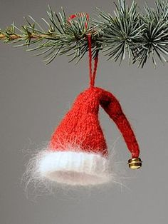 santa's hat pattern here http://www.knit-purl.com/store/pc/Elfin-Santa-Hat-Christmas-Ornament-Kit-244p4206.htm
