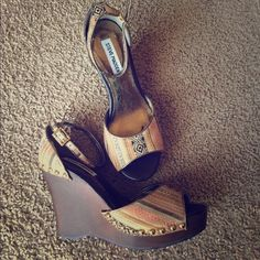 Steve Madden wood wedges These Steve Madden wedges have a wooden base. There is a discoloration on the inside of one shoe as you can see in the pic with the measuring tape. It's not noticeable when wearing. The fabric on the shoe is kind of Aztec patterned with earthy tones of brown, cream, gold, and peach. There are gold studs holding the fabric to the shoe. I tried to get a picture of the inside of the shoe where it is peeling a bit but will not be visible when wearing Steve Madden Shoes…