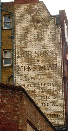 Fading painted sign (ghostsign) for Our Sons Menswear London