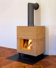 In Austria, Bertram and Harald Müller of Müller Ofenbau have teamed with Martin Rauch of LEHM TON ERDE to create Lehmo , rammed earth wood-. Rammed Earth Homes, Rammed Earth Wall, Super Adobe, Home Fireplace, Fireplaces, Tadelakt, Natural Building, Green Building, Terracota