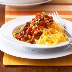 Lose weight with this low-cal pasta alternative. Our spaghetti squash with chili recipe offers a savory, flavorful dinner meal option that's ready in about 90 minutes. Ingredients include spaghetti squash, ground beef, onion, garlic, diced tomatoes and corn. Yum!