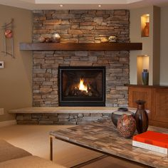 Corner Fireplace Design--Great stone, ample hearth, simple, yet attractive mantle.