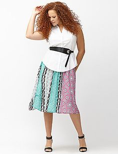 The  midi skirt is swirling to the top of the charts for its fun, feminine and versatile style. Our version offers a colorful mix of prints in breezy chiffon, with an exposed elastic waist for easy pull-on styling. Fully lined.  lanebryant.com