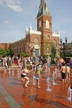 Kids enjoy the splash pad in Old Town in Winchester, Va.