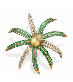 """YELLOW SAPPHIRE, TOURMALINE AND DIAMOND """"FIREWORKS"""" BROOCH, TIFFANY & CO.  Of domed form, set in the center with an oval-shaped yellow sapphire weighing 18.51 carats, framed by 129 round paraiba tourmalines and 78 round diamonds weighing approximately 4.35 carats, mounted in 18 karat gold and platinum, signed Tiffany & Co., c. 1993. With box stamped Tiffany & Co."""