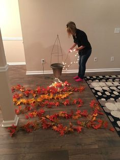 She lays garlands across her floor, then does this with a tomato cage