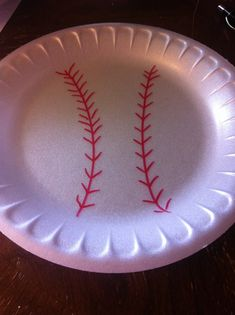 Doing a baseball theme bday party?? What a GREAT and cheap idea for plates. Get styrofoam plates and a red sharpie and draw some baseball threads on the front. And viola you have baseball plates.