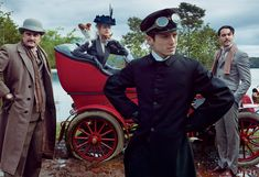 To escape the heat, Wharton, accompanied by intimates Henry James (novelist Jeffrey Eugenides, far left) and Morton Fullerton (actor Jack Huston, far right), motored over the hills and valleys, her loyal chauffeur, Charles Cook (actor Elijah Wood) at the wheel.     On Vodianova: Donna Karan New York pinstriped coat. Stephen Jones Millinery hat. On Eugenides: Paul Stuart coat. On Wood: Coat from Angels the Costumiers. On Huston: Polo Ralph Lauren suit.