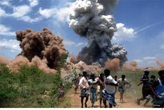 In this Wednesday, Sept. 5, 2012 photo, people run for cover as smoke rises from the site of a fire at a fireworks factory on the outskirts of Sivakasi, about 500 kilometers (310 miles) southwest of Chennai, India. Police in southern India said they have arrested six employees of the fireworks factory for a massive blaze that killed 40 workers and injured 60 others Wednesday. (AP)
