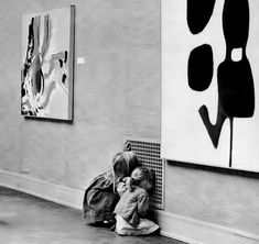 Two girls more engrossed with the air vent grate than the modern art on the walls of the San Francisco Museum of Art, 1963
