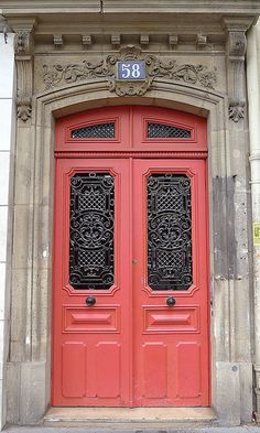 Coral Door in Paris. So gorgeous!