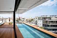 Six stories high, crowned with a pool, and with a direct lineage back to the Bauhaus, a new town house in Tel Aviv manages to both embrace and provide refuge from the teeming Israeli city.