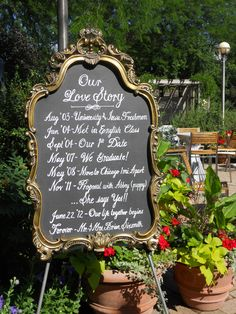 """Our Love Story""  old mirror painted with chalk board paint and printed with Bistro Chalk for wedding reception"