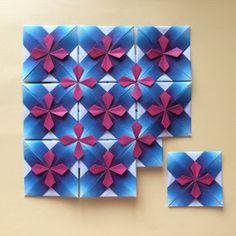 上の図は7.5㎝の折り紙を13枚使っています   お花の部分を折り込むところ(工程11〜14) は細かい作業ですので、はじめは10㎝くらいの折り紙の方が作業がしやすいかもしれません      モザイク模様・お花    1〜7 図のように折りすじをつけてください...