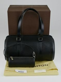 A chic and sophisticated Louis Vuitton bag to carry all your daily essentials. The Louis Vuitton Black Epi Leather Soufflot Bag features a rounded shape with an extra-wide zip closure for easy accessibility. This bag also comes with a matching accessory pouch and has rare silvertone hardware. A perfectly elegant bag for day or night. Retail price is $1280.  The Louis Vuitton Epi Leather collection was first introduced in 1985 and was created to respond to the demand for more durable leather…