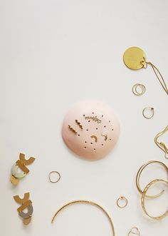 look! a DIY! there are a few things that inspired me to make this — i have so many stud earrings lying around waiting to get lost, i felt like making something very quickly during a nap, and …