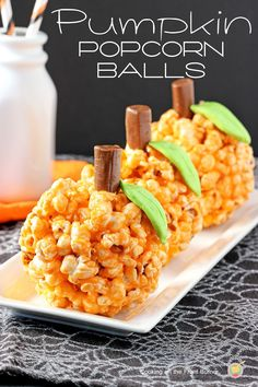 Pumpkin Popcorn Balls from Cooking on the Front Burner. A great Halloween treat to make with the kids.