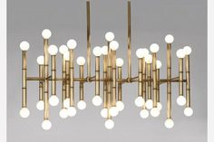 Available in both polished nickel or antiqued brass (seen here), this rectangular chandelier is perfectly poised to be the centerpiece of any dining room. Meurice Rectangle Chandelier ($1,350)