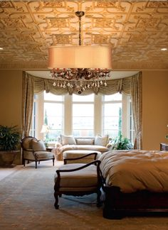 The hues in the shade of our Brentwood chandelier reflect this room's ceiling beautifully.
