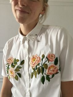 Upcycled classic white shirt- size 12 (brand: Ann Taylor loft) Cropped hem and sleeves Hand embroidered with botanical roses and vines Safety pin flair One of a kind