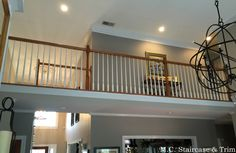 Before the iron baluster upgrade from M.C.Staircase & Trim. Removal of wooden balusters and installation of alternating Single and Double Rings with Plain Bars in Satin Black.
