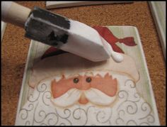 Mod Podge Christmas Napkins onto Tile Coasters.  So going to do this!