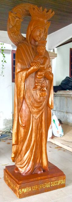 Our Mother of Perpetual Help Statue - is carved in a single block of solid wood (the Halo and Crown of Child Jesus are seperately carved). The height is: 3 meter. The weight is around 1,000 KG. This MPH Statue is the only existing in the world. The place of this MPH Statue is: Bangkok, Thailand.