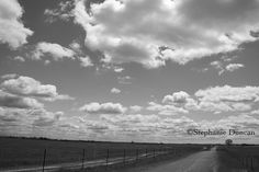 Black and White Clouds and Road