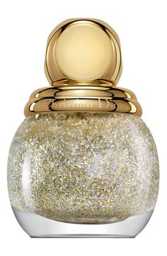 Swooning over this sparkly silver-and-gold nail enamel.