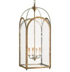 Elegant curves dress up this four light tall, square lantern. The Currey and Company wrought iron frame is finished with a rich Rustic Gold and holds seeded glass panels. x chain. Lantern Pendant Lighting, Foyer Lighting, Rustic Chandelier, Chandeliers, Light Pendant, Kitchen Lighting, Outdoor Lighting, Tall Lanterns, Hanging Lanterns