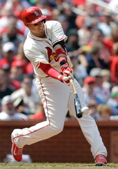 Allen Craig hits an RBI single to allow Kolten Wong to score during the sixth inning of a baseball game against the Atlanta Braves. Cards won 4-1. 5-17-14