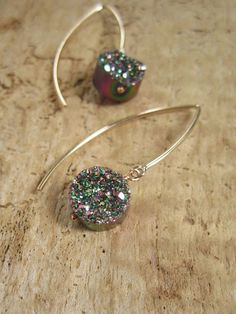 """Dazzling, coin shaped druzy quartz stones glitter from 14K gold fill marquis ear hooks. Natural druzy quartz stones are coated with titanium to deliver a brilliant, consistent rainbow color. The perfect way to add some sparkle to any outfit. Approximately 1 3/4"""" long from top of ear hook. Druzy stones are 3/8 in diameter (10 mm).  Handcrafted with great care. Arrives thoughtfully packaged in a hand stamped eco-friendly kraft box wrapped with ribbon, ready for gift giving or treasur..."""
